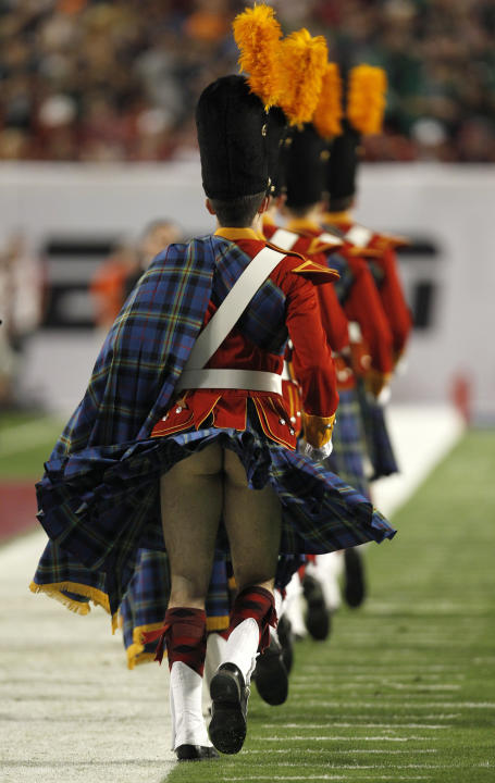 A member of the Notre Dame Fighting Irish band has his kilt blow up before the start of the NCAA BCS National Championship college football game in Miami