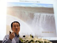 Huang Nubo, chairman of Chinese Zhong Kun Group, speaks in front of a map of Iceland at a press conference in Beijing in 2011. Iceland's government on Tuesday denied a Chinese report that it had given the green light for Huang to lease and develop part of a huge swath of Icelandic wilderness he was blocked from buying last year