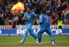 Ravichandran Ashwin (L) celebrates the wicket of Joe Root with Mahendra Singh Dhoni during the ICC Champions Trophy Final between England and India at...
