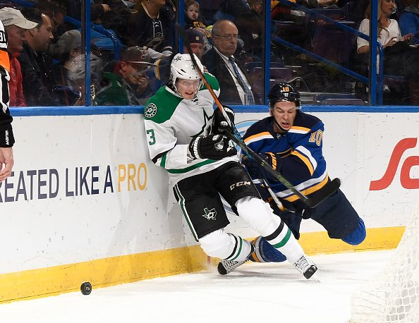 ST. LOUIS, MO - NOVEMBER 28: Scottie Upshall #10 of the St. Louis Blues checks John Klingberg #3 of the Dallas Stars off of the puck at the Scottrade Center on November 28, 2016 in St. Louis, Missouri. (Photo by Scott Rovak/NHLI via Getty Images)