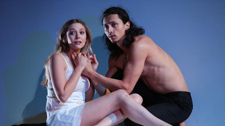 "This photo released by The Publicity Office shows, from left, Elizabeth Olsen and Julian Cihi in a scene from Shakespeare's ""Romeo & Juliet,"" currently performing off-Broadway at Classic Stage Company in New York. (AP Photo/The Publicity Office, Joan Marcus)"