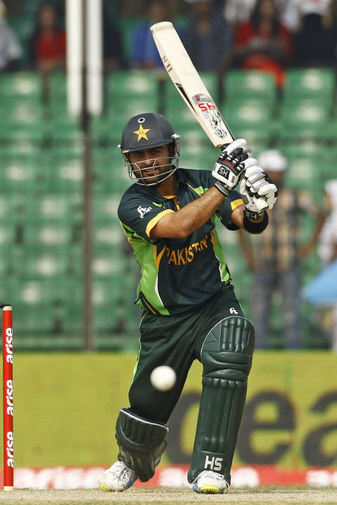 Pakistan's Ahmed Shehzad plays a shot during their match against Afghanistan in the Asia Cup one-day international cricket tournament in Fatullah, near Dhaka, Bangladesh, Thursday, Feb. 27, 2014. (AP