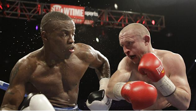 Peter Quillin, left, of the United States, and Lukas Konecny, of the Czech Republic, fight during the first round of their WBO Middleweight World Champion boxing match, Saturday, April 19, 2014, in Wa