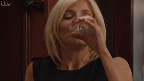 Stella hits the bottle after Karl's arrest.