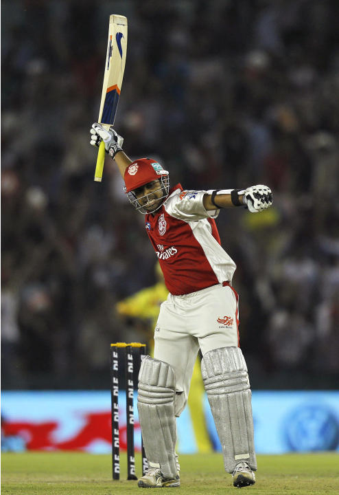 Kings XI Punjab's Paul Valthaty celebrates after scoring a century during an Indian Premier League cricket match between Kings XI Punjab and Chennai Super Kings in Mohali, India, Wednesday, April