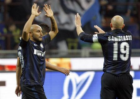 Inter Milan's Jonathan (L) celebrates with his team mate Esteban Cambiasso after an own goal by Livorno's goalkeeper Francesco Bardi (not pictured) during their Italian Serie A soccer match at the San Siro stadium in Milan November 9, 2013. REUTERS/Alessandro Garofalo