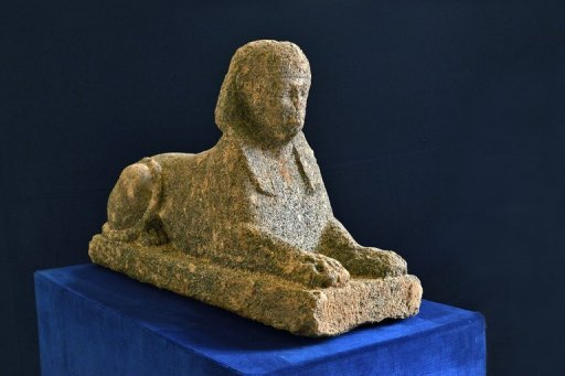 talian police say they have recovered a 2,000-year-old Egyptian sphinx statue that was stolen from a necropolis near Rome and was about to be smuggled out of the country.