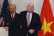 "US Senator John McCain (R) speaks next to US Senator Joseph Lieberman (2nd L) at a press conference in Hanoi on January 19. The United States will not sell lethal weapons to Vietnam until it reverses the ""backward movement"" in its human rights situation, US Senators including McCain said Saturday"