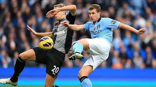 Edin Dzeko scores the winning goal for Manchester City against Tottenham, November 2012