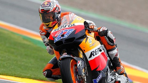 Honda MotoGP rider Casey Stoner of Australia drives his motocycle during the first free practice of the Valencia Motorcycle Grand Prix at the Ricardo Tormo racetrack in Cheste