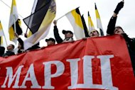"Russian ultra-nationalists wave pre-revolutionary flags and a banner as they take part in the so-called ""Russian March"" in central Moscow on November 4 marking National Unity Day. ""We are the authorities, the authorities are us,"" some participants shouted. ""Putin's clique to trial,"" shouted others. ""We beat Hitler, we will beat Putin."""