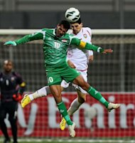 Emirati Mohannad Salem (R) jumps for the ball against Younis Mahmoud of Iraq during their 21st Gulf Cup football match final in Manama, on January 18, 2013. United Arab Emirates defeated former Asian champions Iraq 2-1 in extra-time to claim their second Gulf Cup title in a thrilling final