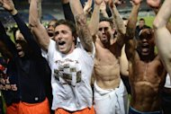 Montpellier's Olivier Giroud (C) celebrates with teammates as Montpellier won their first French Ligue 1 title, after the match against Auxerre, on May 20, at the Abbe-Deschamps stadium in Auxerre. Montpellier won 2-1