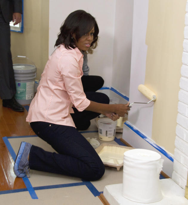 First lady Michelle Obama paints in the home of Army Sgt. Johnny Agbi during a Joining Forcers initiative event, Monday, Oct. 17, 2011, in Washington. Sears, Rebuilding Together and volunteers will co