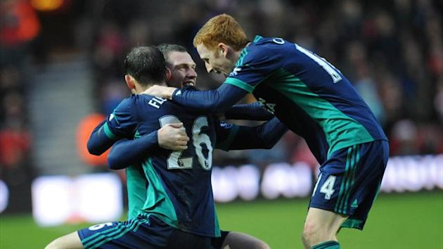 Sunderland's striker Steven Fletcher (L) celebrates scoring the opening goal with English midfielders Craig Gardner (2nd L) and Jack Colback (R) during the English Premier League football match between Southampton and Sunderland at St Mary's (AFP)