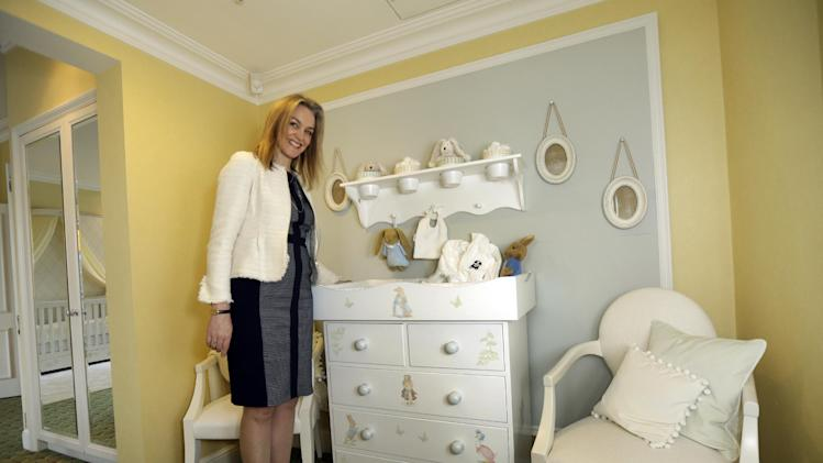 HOLD FOR EURO DESK EARLY RISER STORY SLUGGED BRITAIN ROYAL BABY PLEASE SEND 1:30 EDT TUESDAY MAY 14, 2013 In this Tuesday, April 30, 2013 photo, Lucinda Croft, the managing director of Dragons, a small British family business that was also tapped to design nurseries for British royals, poses for the photographer next to a luxury baby changing unit at a hotel nursery suite, designed by Dragons, at a central London hotel. Britain's Prince William and Kate, formally known as the Duchess of Cambridge, plan to move into apartments at London's Kensington Palace soon after the baby is born in July. Few will ever get a glimpse inside the room where the future British monarch will grow up, but the designers hired by late Princess Diana to create her sons' William and Harry's nursery at the palace can offer some expert hints. (AP Photo/Lefteris Pitarakis)