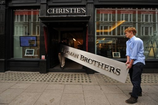 A Lehman Brothers company sign appears at Christie's auction house in London in 2010. The liquidator of Lehman Brothers, the investment bank that collapsed spectacularly in the financial crisis, said Monday it had sold off a property unit for $6.5 billion.