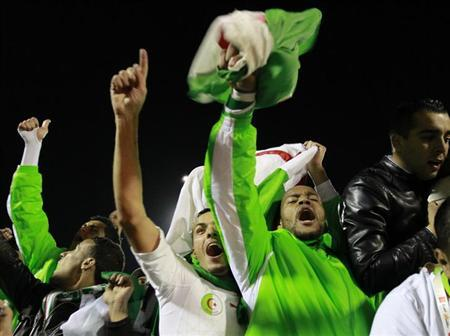 Algeria's Rais Mbolhi (2nd R) and Fouad Kadir celebrate after winning their 2014 World Cup qualifying second leg playoff soccer match against Burkina Faso at Tchaker Stadium in Blida, November 19, 2013. REUTERS/Louafi Larbi