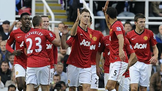 Manchester United's Jonny Evans (C) celebrates scoring against Newcastle United with teammates during their English Premier League soccer match in Newcastle, northern England, October 7, 2012 (Reuters)