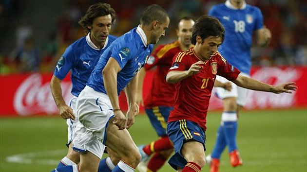 Italy's Leonardo Bonucci and Andrea Pirlo (L) challenge Spain's David Silva (R) during their Euro 2012 final