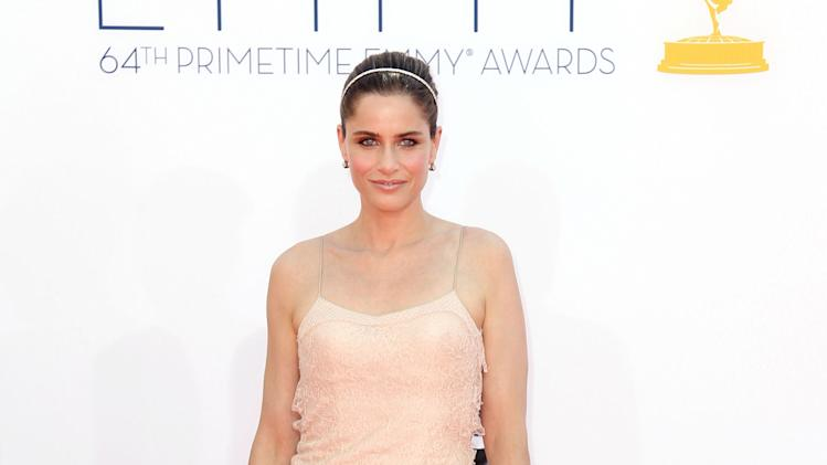 Amanda Peet arrives at the 64th Primetime Emmy Awards at the Nokia Theatre on Sunday, Sept. 23, 2012, in Los Angeles. (Photo by Matt Sayles/Invision/AP)