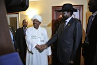 Sudanese President Omar al-Bashir (centre left) shakes hands with his South Sudanese counterpart Salva Kiir (centre right) following a meeting in the Ethiopian capital Addis Ababa, on July 14. The handshake came after their first face-to-face talks on Saturday since the border fighting took them to the brink of all-out war