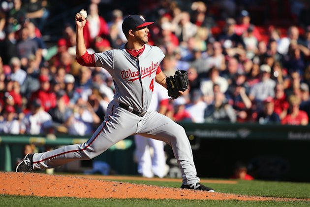 BOSTON, MA - APRIL 15: Rafael Martin #52 of the Washington Nationals pitches against the Boston Red Sox while wearing the #42 to commemorate Jackie Robinson Day during the eighth inning at Fenway Park on April 15, 2015 in Boston, Massachusetts. (Photo by Maddie Meyer/Getty Images)