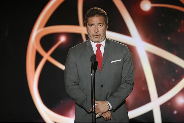 Benito Martinez presents a College Television Award at the 35th College Television Awards, presented by the Television Academy Foundation at The Leonard H. Goldenson Theatre in the NoHo Arts District