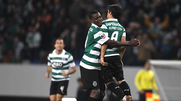 Sporting's Andre Martins celebrates his goal with his teammate William Carvalho during their Portuguese Premier League soccer match against Belenenses in Lisbon