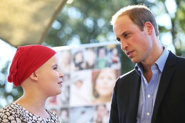 Britain's Prince William talks to a patient during his visit to Bear Cottage, a hospice for children, in Sydney