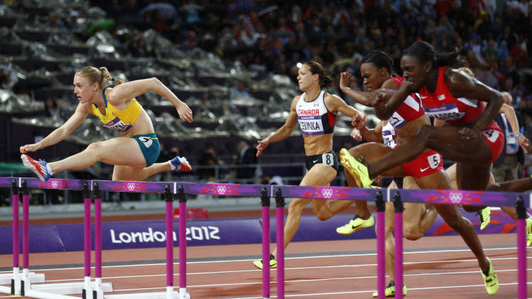 Australia's Sally Pearson clears a hurdle to win gold in the women's 100m hurdles final during the London 2012 Olympic Games at the Olympic Stadium