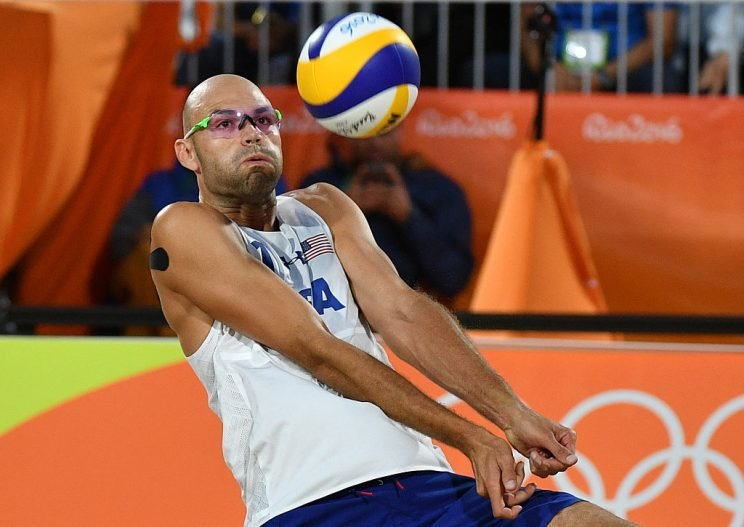USA's Phil Dalhausser controls the ball during the men's beach volleyball qualifying match between USA and Italy at the Beach Volley Arena in Rio de Janeiro on August 11, 2016, for the Rio 2016 Olympic Games. / AFP / Leon NEAL (Photo credit should read LEON NEAL/AFP/Getty Images)