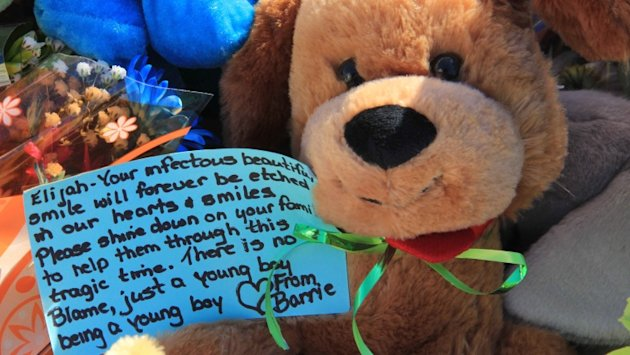 A teddy bear is left for Elijah Marsh, a boy who wandered out of his home and died this winter. (CBC)