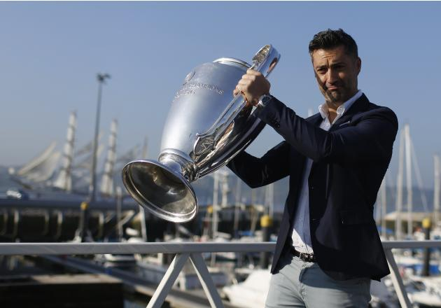 Former Portuguese player Vitor Baia holds the Champions League trophy during a parade around the city in Lisbon