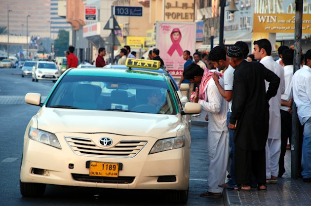 Customers flag a taxi on a busy road in Dubai. (Photo: Donna.M.Bee.Photography)