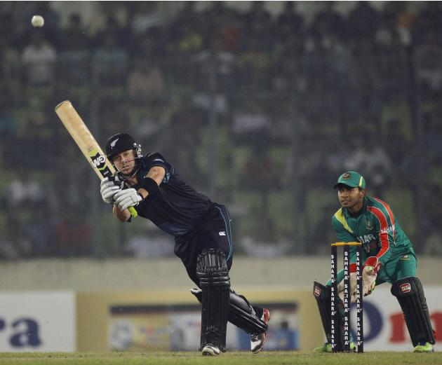 New Zealand's McCullum plays a shot as Bangladesh's Rahim watches during their second one-day international cricket match in Dhaka