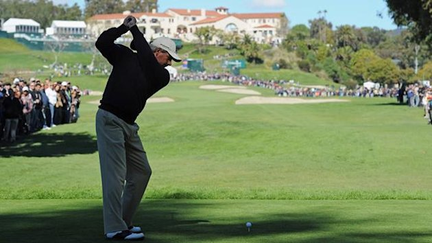 Fred Couples plays his tee shot on the nineth hole during the final round of the Northern Trust Open at Riviera Country Club