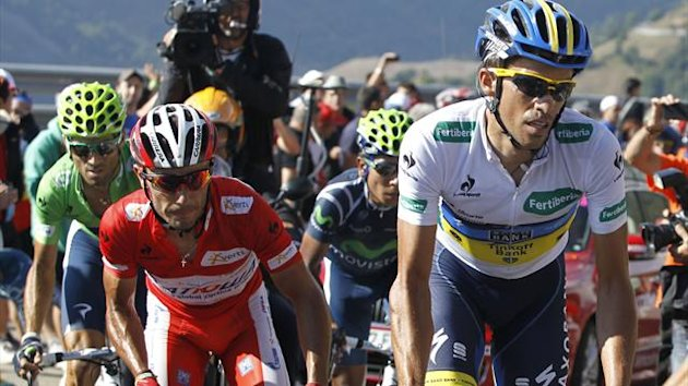 "Katusha Team rider and leader of the race Joaquim ""Purito"" Rodriguez (C) of Spain, Team Saxo Bank rider Alberto Contador (R) of Spain"
