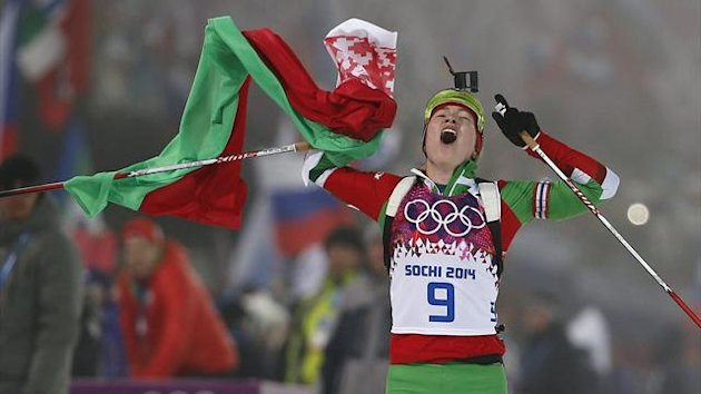 Darya Domracheva of Belarus celebrates after crossing the finish line during the women's biathlon 10km pursuit (Reuters)