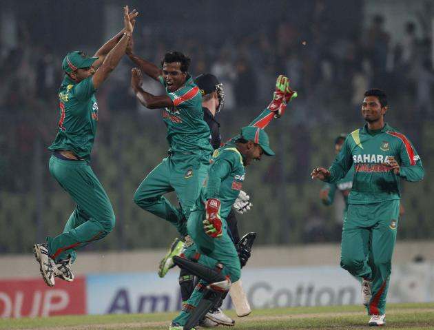 Bangladesh's Hossain celebrates with teammates after he dismissed New Zealand's Neesham as he made a hattrick during their first one-day international cricket match in Dhaka