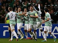 Celtic's Scottish striker Tony Watt (C) celebrates scoring during their Champions League group match against Barcelona, in Glasgow, on November 7. Celtic's stars will come back to earth on Sunday following their 2-1 CL win over Barca as they prepare for a Scottish Premier League tie against St Johnstone
