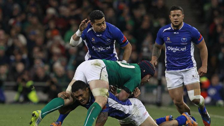 Ireland's Sean O'Brien is challenged by Samoa's John Leota during their international rugby union match at Aviva stadium in Dublin