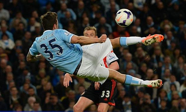 Manchester City's Stevan Jovetic attempts a scissor kick during their English Premier League match against Sunderland, at the Etihad Stadium in Manchester, on April 16, 2014