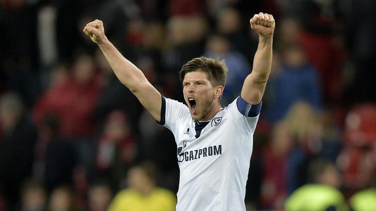 Schalke's Klaas-Jan Huntelaar of the Netherlands celebrates after winning the German Bundesliga soccer match between Bayer Leverkusen and FC Schalke 04 in Leverkusen,  Germany, Saturday, Feb. 15, 2014. Leverkusen was defeated by Schalke with 1-2, Huntelaar scored the decisive goal