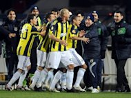 Fenerbahce players celebrate after scoring during the Europa league football match Lille vs Fenerbahce on February 18, 2010 in Lille. Turkish police have arrested around 30 people, including the president of top side Fenerbahce as part of an ongoing investigation into match-fixing in football, the Anatolia news agency reported