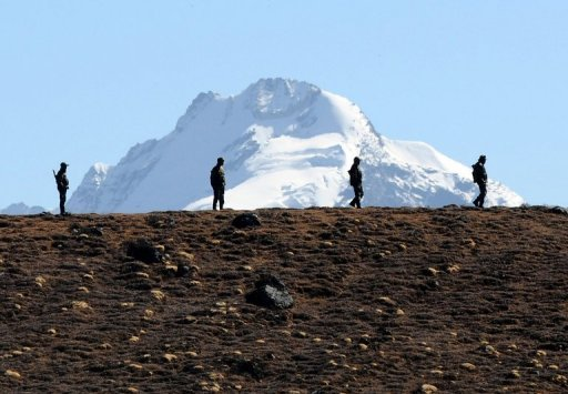 Indian soldiers keep vigilance at Bumla pass at the India-China border in Arunachal Pradesh, on October 21, 2012. Dozens of Chinese soldiers have set up camp in a remote region claimed by India, according to Indian government sources.