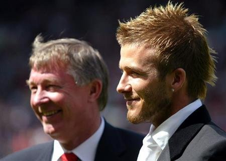 Manchester United's David Beckham (R) stands with manager Sir Alex Ferguson before their match against [Charlton Athletic] in the English premier league match at Old Trafford, Manchester, May 11, 2002.