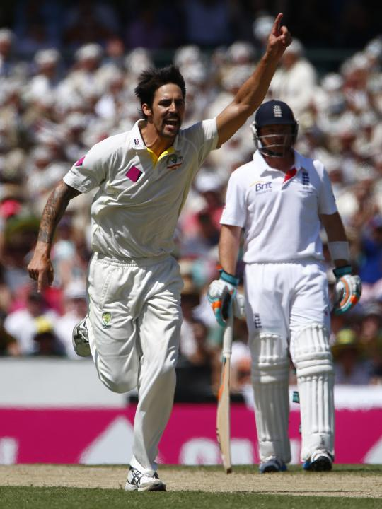 Australia's Johnson celebrates after taking the wicket of England's Anderson, next to England's Bell during the second day of the fifth Ashes cricket test at the Sydney cricket ground