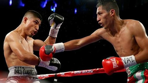 Mikey Garcia (left) and Juan Carlos Burgos exchange punches during the WBO Junior Lightweight title match at Madison Square Garden on January 25, 2014 in New York City