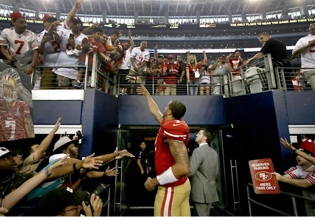 San Francisco 49ers quarterback Colin Kaepernick (7) interacts with fans after their 28-17 win over the Dallas Cowboys in an NFL football game, Sunday, Sept. 7, 2014, in Arlington, Texas. (AP Photo/To